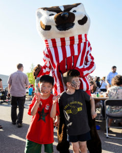 Bucky badger posing with children