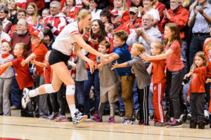 Badger Haleigh Nelson high fives fans