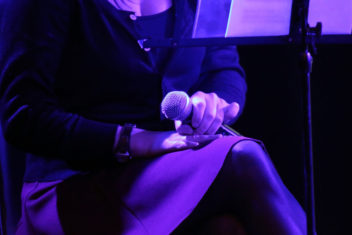 Woman with microphone on stage